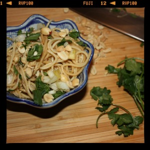 spicy peanut noodles on cutting board